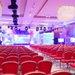 Conference event with a computer screen projecting for an on stage presentation, organised by an event management company