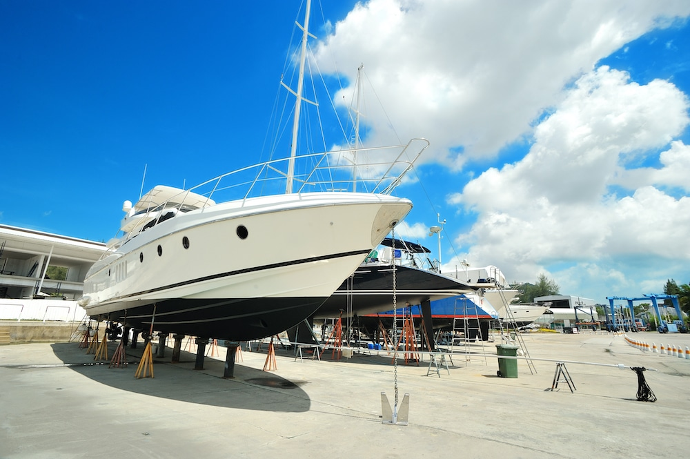 Image of yacht in dry dock as link to business IT support for marine and yachting industry
